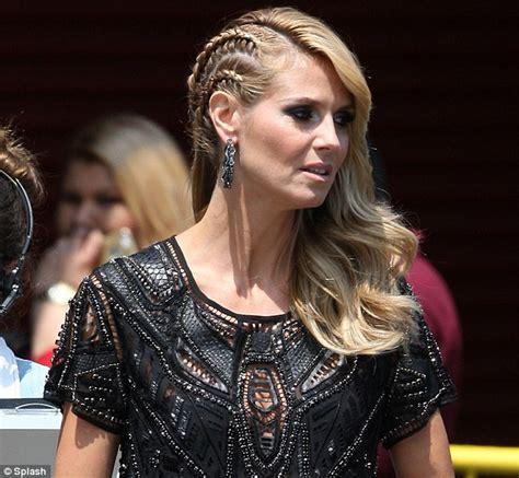 hairstyles on 1 side of head heidi klum spots corn row style braids sheer black blouse