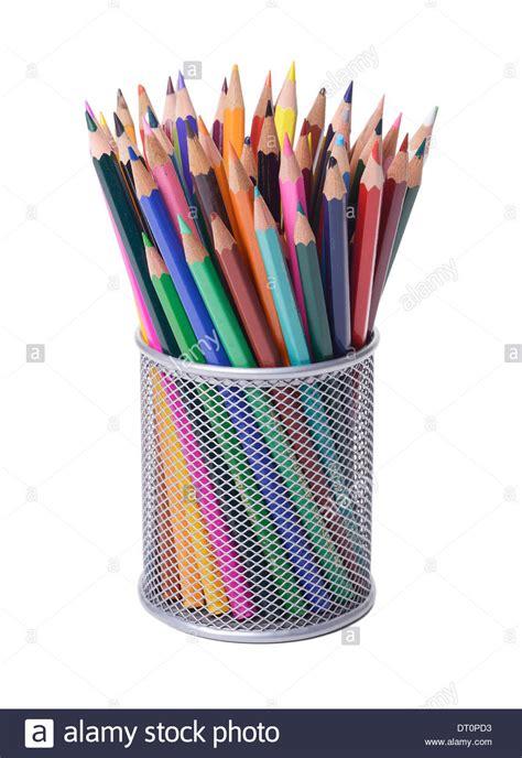 desk pot office desk pencil pot of coloured pencils stock