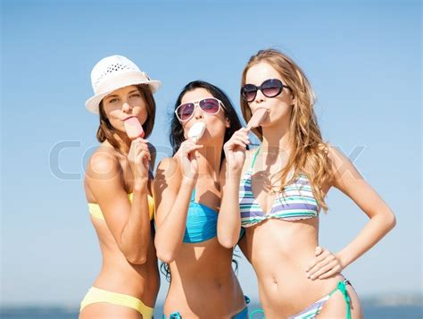 Beach Home Plans by Girls In Bikinis With Ice Cream On The Beach Stock Photo