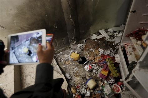 el chapo house a journalist takes photographs of scattered food items in the kitchen at a safe house