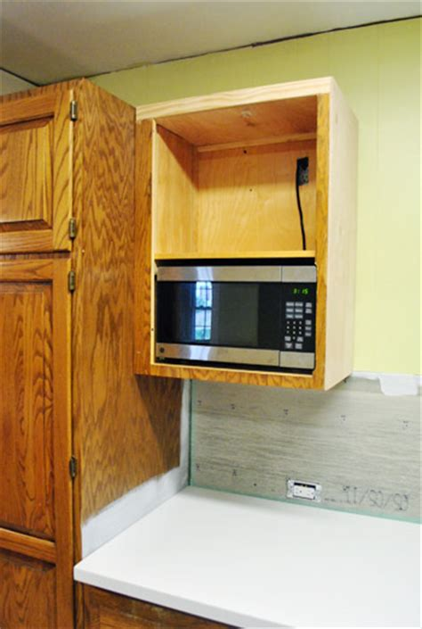 Removing Kitchen Cabinets how to hide a microwave building it into a vented cabinet