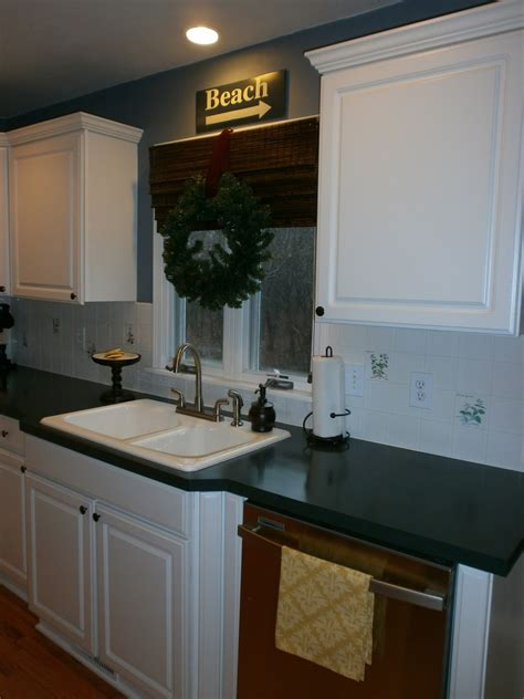 older and wisor painting a tile backsplash and more easy diy painting a ceramic tile backsplash