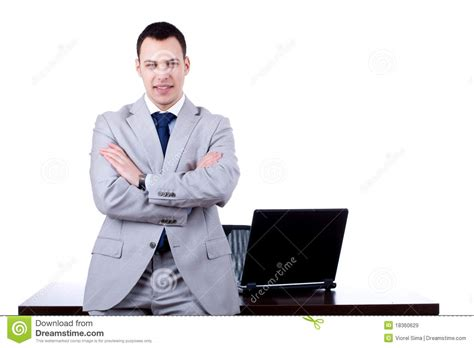 Business Man Leaning On Office Desk Royalty Free Stock
