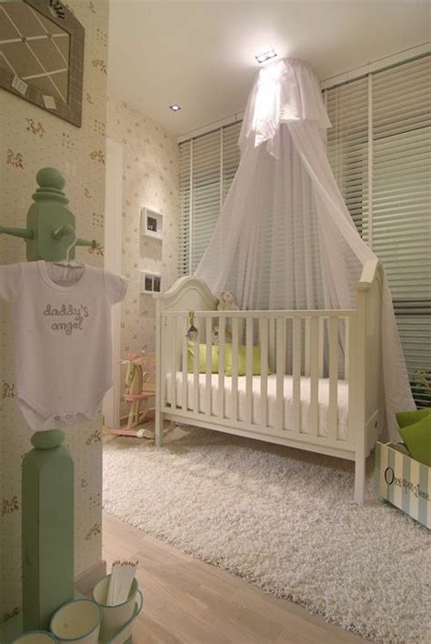 drapes over crib love the idea of the sheer curtain over the crib