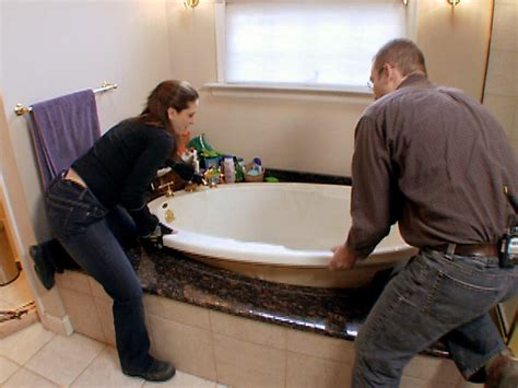 how to change out a bathtub how to install a whirlpool bathtub how tos diy