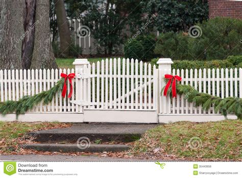 images of christmas garland on a fences white picket fence garland and bow iii stock photo image 35443656