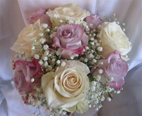 Bridesmaid Bouquet by Bouquets Floral Designs By