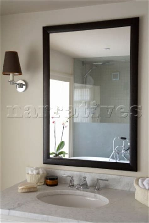 mirror design ideas sussex above black framed bathroom