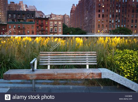 new york bench bench at high line park in new york city with buildings in