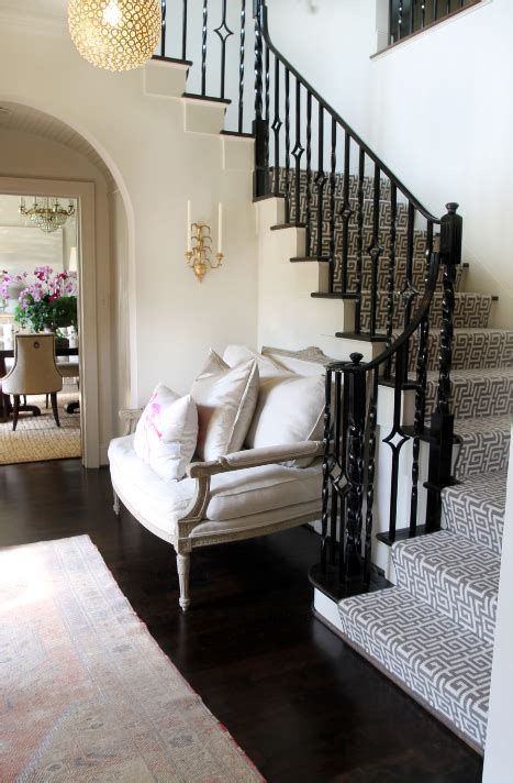 black staircase black stair railing contemporary entrance foyer lucy