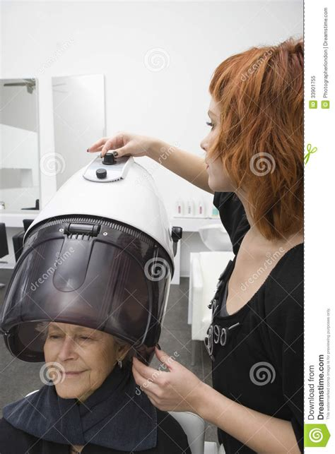 Sit Hair Dryer senior hooded hair dryer in salon royalty free