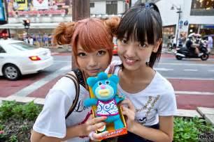 japanese hairstyles buns cute shibuya girls w high waisted shorts double bun hair