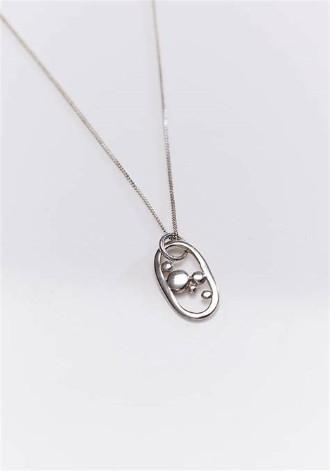 silver oxygen pendant and chain by reeves jewellery