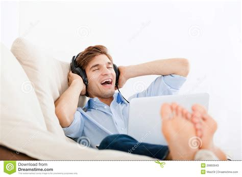 music on the couch man listening music stock photos image 29893943