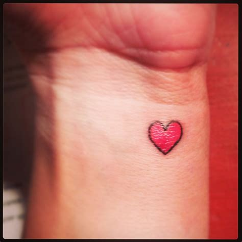 small pink heart tattoo 25 tiniest and cutest tattoos
