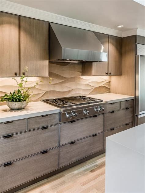 578 best images about backsplash a neutral limestone backsplash contrasts the lines of the wood grain in the hardwood