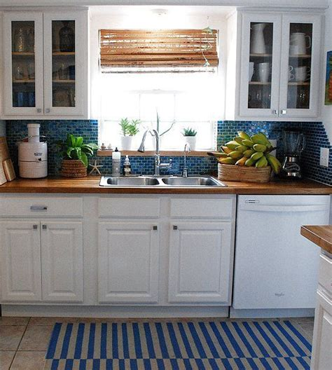 white kitchen cabinets with butcher block countertops butcher block counter tops in blue and white kitchen white cabinets blue backsplash butcher