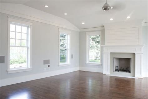 light gray walls with white trim wood floors home