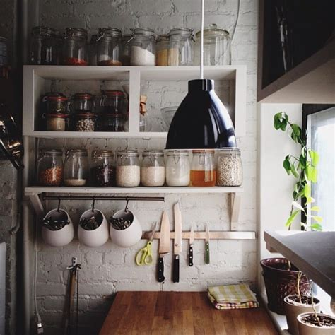 Creative diy wood wall mounted kitchen shelving units with hooks painted with white color for