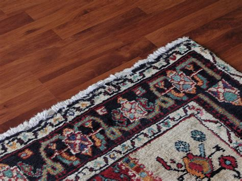 Accenting Your Hardwood Floors With An Area Rug Jke Area Rug On Hardwood Floor