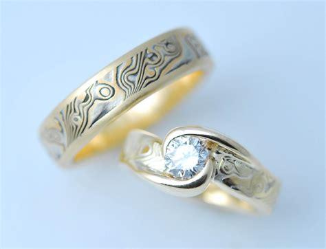 hand made custom mokume gane two ring wedding set by