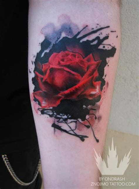 an abstract watercolor tattoo of a red rose flower by