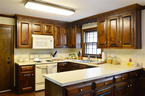 how to remove a kitchen cabinet removing some kitchen cabinets rehanging one young