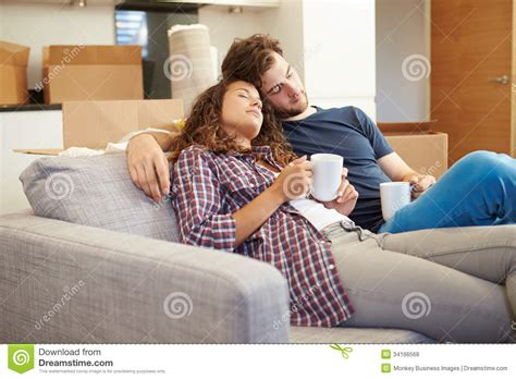 hot in sofa tired couple relaxing on sofa in new home royalty free