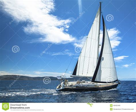 sailing boat in big waves sailing in the wind through the waves sailing stock