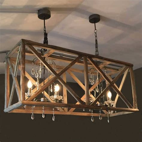 large wooden chandelier with metal and wooden
