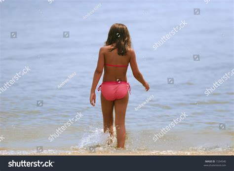 young girl with bathing suit stock photo young girl bathing suit walks into stock photo 1534540