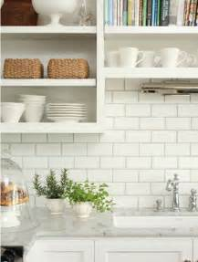 white subway tile backsplash with dark grout car