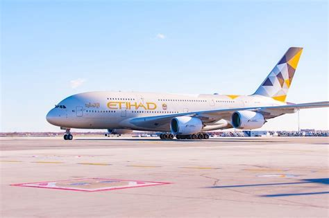 emirates or etihad emirates and etihad to suspend flights to and from qatar