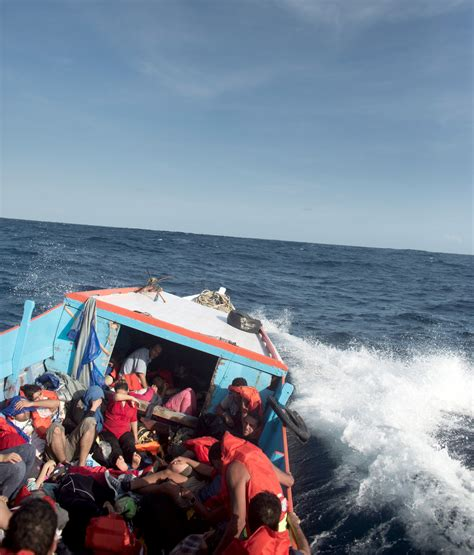 show port side of boat over 1 000 refugees have died trying to reach christmas