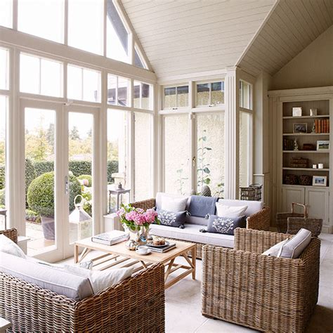 country conservatory with wicker furniture decorating
