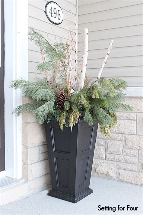 christmas decorating huge stone urns in front of entrance winter entryway decor and curb appeal ideas setting for four