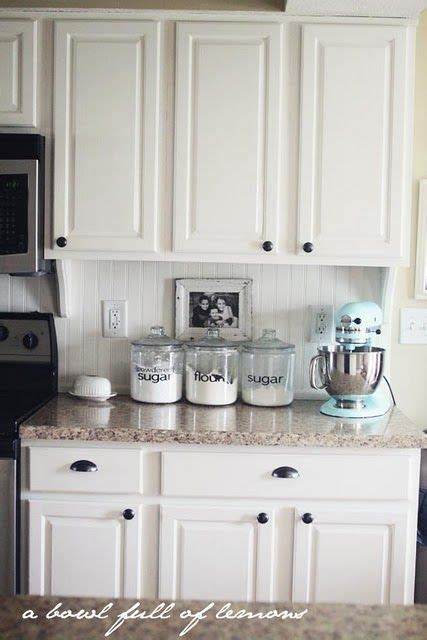 White Beadboard Kitchen Cabinets by Canisters With Dicut Letters Color Of Countertop White
