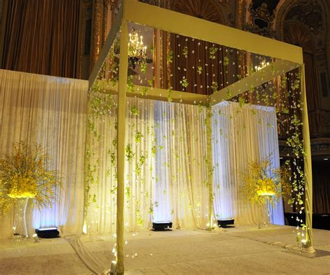 Golden mandap design with low hanging crystals and yellow