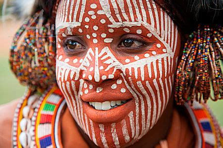 kikuyu woman with face paintings, jewel and ornamental
