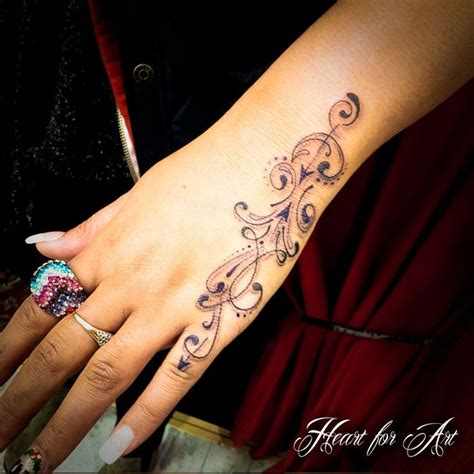 Tattoo Hand Pinterest | swirl tattoo on girl left hand tattoos pinterest
