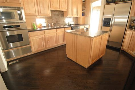 Linoleum for floor idea, light oak cabinets with dark wood