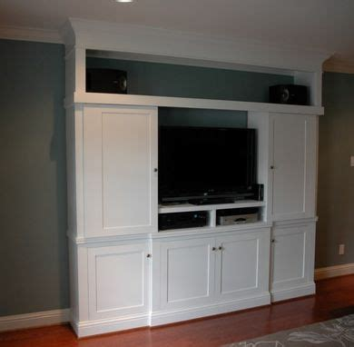 entertainment center cabinet doors made custom entertainment center with sliding doors by custom cabinets trim carpentry