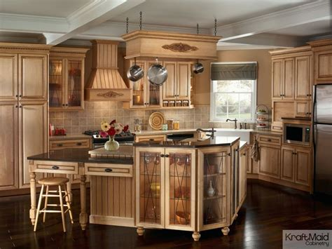 kraftmaid kitchen island this traditional kitchen with kraftmaid cabinetry and a multi tiered island provides a balance