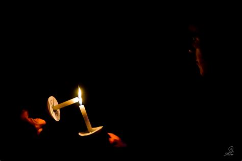 Lighting Candles by Candle Light Fillmer