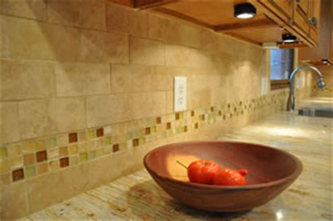 limestone backsplash with glass tile accent tile backsplash ideas kitchen backsplashes photos designs