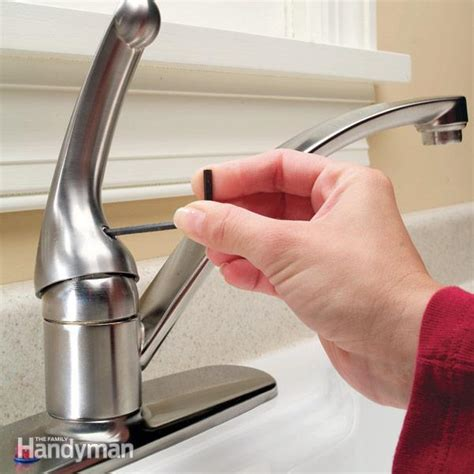 fixing a leaky kitchen faucet how to repair a single handle kitchen faucet the family handyman