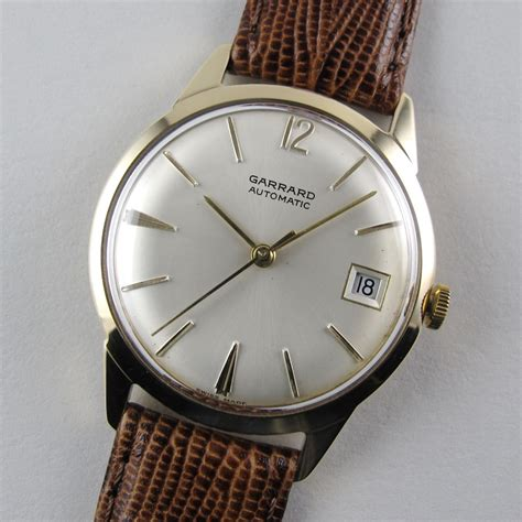 gold garrard vintage wristwatch hallmarked 1968 black