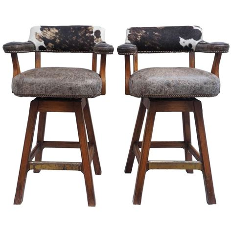 leather swivel bar stools at 1stdibs pair of swivel stools cowhide and leather 1980s at 1stdibs
