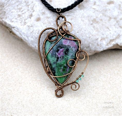 ruby zoisite wire wrapped pendant by ianirasartifacts on