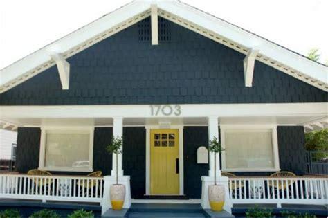 gray house yellow door who has a yellow door simply grove